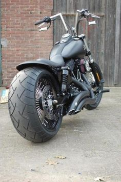2013 Street Bob. Slightly modified of course.   Real cool bike.  Would love to own one.