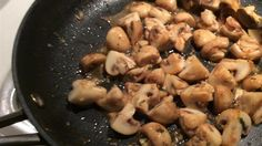 Mushrooms and garlic are cooked in butter then simmered in red wine.