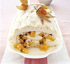 Try this indulgent, rich and creamy (but low-fat and gluten-free!) mango and passion fruit roulade recipe from BBC Good Food. Bbc Good Food Recipes, Sweet Recipes, Cooking Recipes, Delicious Desserts, Dessert Recipes, Yummy Food, Meringue Roulade, Gluten Free Party Food, Roulade Recipe
