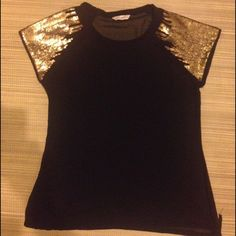 Black sheer sequence top Black sheer sequence top with a tie on the bottom in size large. Willing to trade Tops Blouses