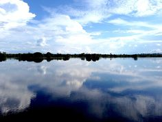 Pure reflection: A giant body of darkly colored water reflecting the clear blue skies of mid-May. (Photo by Indra Febriansyah)