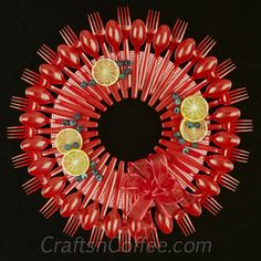 http://craftsncoffee.com/2014/07/03/serving-up-a-picnic-wreath-made-with-plastic-spoons-and-forks/