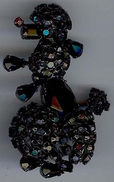Vintage black rhinestone poodle pin with red rhinestone nose.