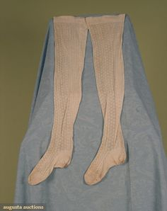 Late 19th Century Lady's Stockings  White thin cotton stockings knit with geometric patterns from foot to top hem.
