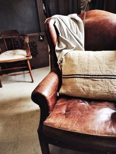 cosy leather armchair lovingly repinned by www.skipperwoodhome.co.uk