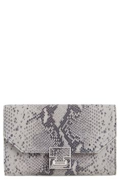 Make traveling a breeze with this snake-embossed leather clutch that makes organizing a cinch. A removable insert features labeled pockets for the passport, tickets, receipts and documents, which helps avoid frantic searching for train tickets or customs clearance.