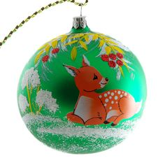 """Fawn"" Hand Blown Christmas Ornament (Green) is 3.74"" (95 mm) in diameter and made of hand blown glass. It is hand painted by a skilled artist and will be a beautiful addition to your Christmas ornaments collection. Each glass ornament is painted individually which makes them unique and adds some small variations to each product. Made in Russia."