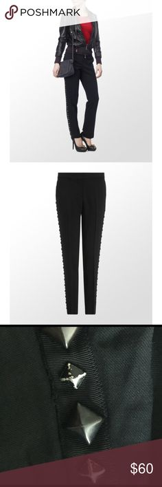 """BCBGMaxAzria Tapered Trousers Add edge to eveningwear with BCBG Max Azria's embellished tailored trousers. Simply add a pair of glossy stilettos or choose a smart casual look by teaming with a clean white T. Tuxedo style trousers with studded detail Zip hook and eye fly 4 pocket styling Studded detail on sides Inner leg approx. 73cm 58% viscose, 40% wool, 2% spandex Hand wash cold. Some paint has worn off on the pyramid spikes (see photos). Inseam: approx 29"""" BCBGMaxAzria Pants Trousers"""
