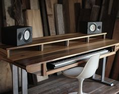 SPECS// - sun tanned poplar wood - 2 raw steel u frame bases (+$50) - Table Top: 74 wide - 33 deep - 32 tall. - Rackmount Shelf: 64 wide x 15 deep x 40 tall from ground - Fits 2 sets of speaker monitors and 1 27 display or 2 (22 displays) and smaller speaker monitors - 12 rack unit spaces - Heavy Duty slide out keyboard drawer - Fits up to 49 key workstations up to 120lbs - Hidden cable/hard drive shelf underneath to keep things tidy and uncluttered. - Heavy Duty natural satin...