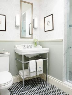 chrome legs - takes up less space than a cabinet but offers more storage than a pedestal. #vintagebathroomsink