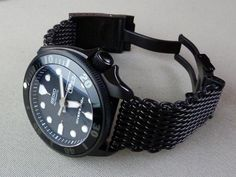 SKX007 DLC coated fitted with a Murphy bezel, Dagaz superdome sapphire and stealth insert, SKX171 dial and Ti Samurai hands