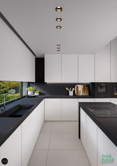 Black countertops in white kitchen