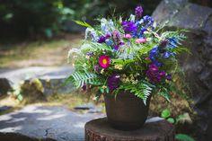 Unique, colorful wedding flower arrangement - blue, purple and green flower arrangements with ferns {Hannah Wahl Photography}
