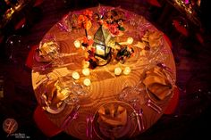 great tablescape- awesome tablecloth and lighting