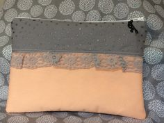 Www.facebook.com/tamerlanesewing Handcrafted zipper pouch.