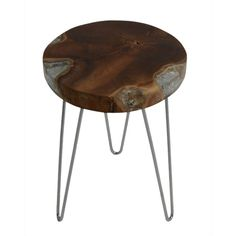 Give your living space a rustic-chic accent with this side table boasting retro leg designs and a weathered wood top.