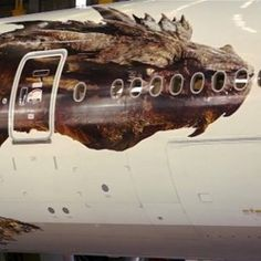 Air New Zealand Launches The Hobbit: The Desolation of Smaug Themed Airplane -- The enormous dragon Smaug is being featured on the side of a Boeing 777-300ER. Watch a time lapse video of the aircraft being built. -- http://wtch.it/0tmFD
