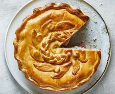 Use up the Christmas leftovers to make this hearty, deep-filled turkey and ham pie. You could use shop-bought pastry but nothing beats homemade turkeyandhampie Bbc Good Food Recipes, Pie Recipes, Savoury Recipes, Turkey And Ham Pie, Christmas Turkey, Christmas Stuff, Christmas Ideas, Bakewell Tart, Christmas Cooking