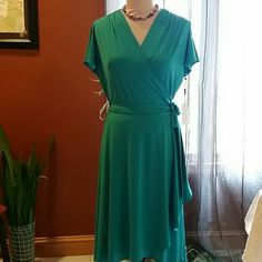 Vicky Tiel Wrap Dress Georgeous TEAL wrap dress with side scallop edge (pic 3). Ruching at the shoulders with split sleeve design for extra detail. Super comfortable and perfect for dressing up or casual. Great for EASTER. 14 1/2 inches from shoulder to waist, waist to hem is 30 inches long. 95% polyester 5% spandex WILL FIT A LARGE TOO! Vicky Tiel  Dresses