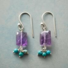 These lovely turquoise and amethyst dangle earrings catch and reflect the light to stunning effect.