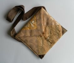 Gold and brown, unique patchwork shoulder bag, with a triangular front flap £25.00
