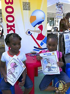 This is a photographs of twins in Harlem NY. We were set up for children to color Brave Little Dave. These sisters are so cute!