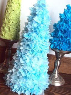 Tissue Paper Christmas Trees...super cute and easy, reminds me of arts and crafts in elementary school!  You could do this with feathers instead of tissue paper as well...
