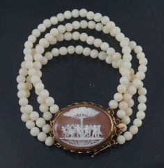 Carved Shell Cameo Set In 14k Yellow Gold, With Bracelet Consisting Of Four Rows Of Beads
