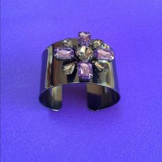 """💜Join this Fall's Trend of Purple Colors 💜Join this Fall's Trend of Purple Colors💜  💜Violet Cuff Bracelet💜  Violet Cuff bracelet with hematite-color faceted faux stones. Dark gun metal color and measures 1.5"""" wide.  It's absolutely Stunning and Perfect for the Fall and Winter!   Open cuff back.  One size fits most.  New in box.  🚫Final Price🚫 🚫NO TRADES🚫 Avon Jewelry"""