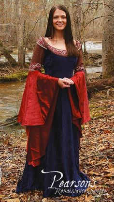 This magnificent, houppelande gown has become essential garb for all real Elven Queens. The regal blue gown with coral sleeves is made of airy Medieval Costume, Medieval Dress, Medieval Clothing, Vestidos Viking, Queen Dress, Dress Up, Larp Fashion, Elven Queen, Marine Uniform