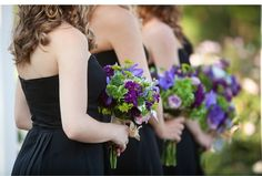 EXACTLY!!! Black bridesmaids dresses, with purple and green flowers. Perhaps a few white flowers included, but otherwise, just how I want our day to look! :)