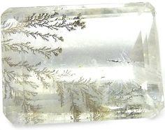 Quartz Dendritique.  Such beautiful traceries.  http://www.gems-plus.com/gemmes/quartz-dendritique.php