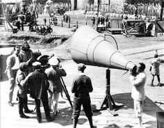 Douglas Fairbanks speaking through a huge megaphone on the set of Robin Hood (1922) | silentfilm.org