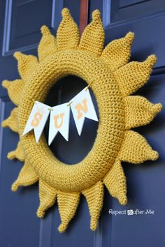 Sun wreath. love the yellow on the navy blue door!
