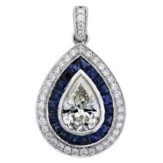 1 Carat Pear Shape Diamond and Sapphire Pendant in Platinum | From a unique collection of vintage necklace enhancers at https://www.1stdibs.com/jewelry/necklaces/necklace-enhancers/