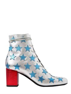 Silver BABIES METALLIC LEATHER ANKLE BOOTS by Saint Laurent with stars and red heel.