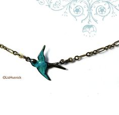 teal sparrow necklace! want!  LizHutnick