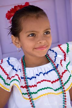 Central America, Nicaragua, Granada.  Girl in traditional dress after dance