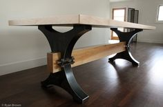 Reclaimed bowling alley lane table top on a custom blackened steel base.