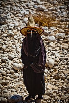 The women in the tribal region Hadramawt are dressed all in black and wearing conical straw hats shaped like witches' hats, Wadi Doan, Hadramaut, Yemen. Photo by by Anthony Pappone.
