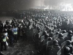 Riot police officers gather as they clash with protesters in the centre of Kiev on January 22, 2014. Ukrainian police today stormed protesters' barricades in Kiev as violent clashes erupted and activists said that one person had been shot dead by the security forces. The move by police increased tensions to a new peak after two months of protests over President Viktor Yanukovych's failure to sign a deal for closer ties with the EU. Pic: AFP PHOTO/ANATOLII BOIKO Source: AFP