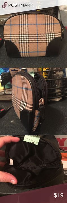 Small plaid makeup bag Never used. Part of the tags still attached as shown on the photos. Zipper closure. Brand unknown. Bags Cosmetic Bags & Cases