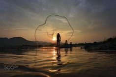 Fisherman in Meakong river - two fisherman net in meakong river Thailand