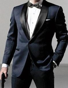 Step into 007 this Halloween, with the perfect James Bond Tuxedo costume. The best part is after your event you still have a beautiful tuxedo to wear at future events and weddings. This 1 button tuxedo, features a satin shawl lapel, modern flat front pants, and side vents.Pants come 6 inches smaller than jacket size, and can be adjusted 2 inches out or 4 inches in. #PromTuxedo #Tuxedo #BlueTuxedo #WeddingTuxedo #PromTux #WeddingTux #Tux #Wedding #Prom