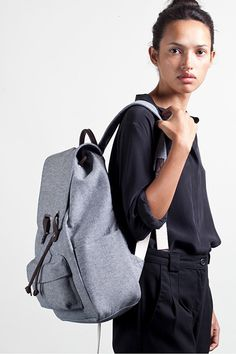 Everlane Twill Snap Backpack.   https://www.everlane.com/collections/womens-backpacks/products/womens-twill-backpack-reverse-denim