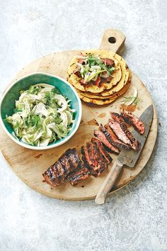 This raw fennel and celery salad brings light and bright flavor to grilled marinated skirt steak. Throw corn tortillas on the grill to...
