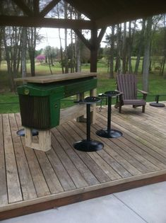 John Deere Tractor table/bar with tractor stools. Tractor Bar, Tractor Seat Bar Stools, Tractor Decor, Car Furniture, Automotive Furniture, Automotive Decor, Repurposed Furniture, Industrial Furniture, Rustic Furniture