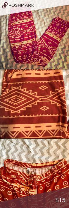 LuLaRoe OS Aztec Print Leggings Buttery soft original waist band lula leggings. Worn a few times. Washed per LLR standards. Dark orange and light orange pattern. Price is firm unless bundling. LuLaRoe Pants Leggings