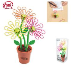 Fred & Friends Desk Daisy. The petals are colorful paper clips that cling to magnets in the center of each flower, and the stems are bendable.