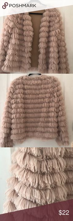 New  faux fur Fluff jacket in nude This jacket is so soft and light and full of fluff. I bought for myself an XL in China so like a Large here or even cute on a medium. My broad back just doesn't look good in this. Fluff can be a little light on top of shoulders but it is just adorable Jackets & Coats